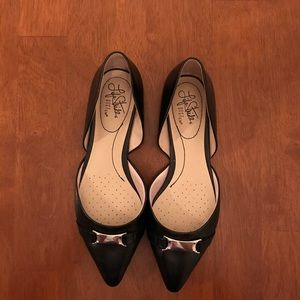 Black pointed toe flats with buckle